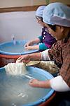 Artisans make washi paper at Iwano Heizaburo Seijijo in Echizen, Fukui Prefecture, Japan on 21 Feb. 2013. Photographer: Robert Gilhooly  .Artisans remove impurities from the fibers used in washi paper making at Iwano Heizaburo Seijijo in Echizen, Fukui Prefecture, Japan on 21 Feb. 2013. Photographer: Robert Gilhooly    .