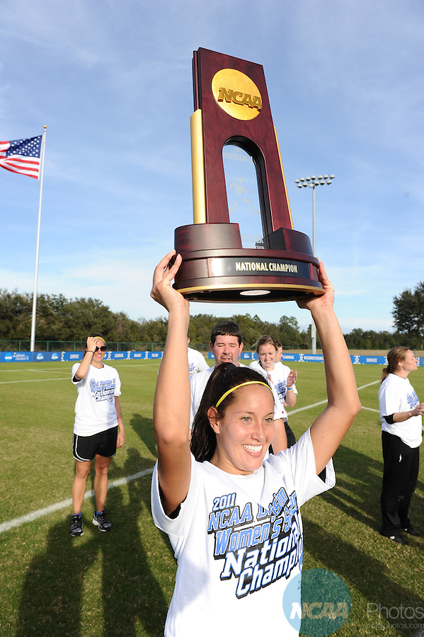 03 DEC 2011: Gianna D'Errico (22) of Sain Rose celebrates with the championship trophy during the Division II Women&rsquo;s Soccer Championship held at the Ashton Brosnaham Soccer Complex in Pensacola, FL.  Saint Rose defeated Grand Valley State University 2-1 to win the national title.  Stephen Nowland/NCAA Photos