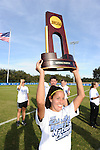 03 DEC 2011: Gianna D'Errico (22) of Sain Rose celebrates with the championship trophy during the Division II Women's Soccer Championship held at the Ashton Brosnaham Soccer Complex in Pensacola, FL.  Saint Rose defeated Grand Valley State University 2-1 to win the national title.  Stephen Nowland/NCAA Photos