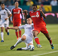 CARSON, CA – June 11, 2011: LA Galaxy forward Chad Barrett (11) and Toronto FC defender Doneil Henry (4) battle for the ball during the match between LA Galaxy and Toronto FC at the Home Depot Center in Carson, California. Final score LA Galaxy 2, Toronto FC 2.
