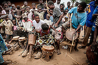 People play drums during the witchdoctor's initiation ceremony.