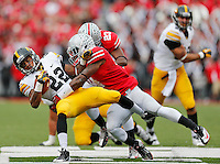 Ohio State Buckeyes safety C.J. Barnett (4) takes down Iowa Hawkeyes wide receiver Damond Powell (22) in first half action at Ohio Stadium on October 19, 2013.  (Chris Russell/Dispatch Photo)