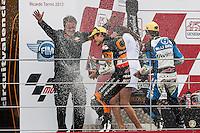 Marc Marquez, Emilio Alzamora, Julian Simon, celebrates in the podium