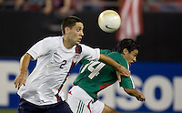 USA's Clint Dempsey battles Mexico's Gonzalo Pineda for the ball. USA 2, Mexico 0, at the University of Phoenix Stadium in Glendale, AZ on February 7, 2007.