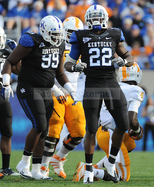 UK Linebacker Danny Trevathan celebrates after sacking Tennessee Quarterback Tyler Bray during the third quarter of the University of Kentucky football game against Tennessee at Commonwealth Stadium in Lexington, Ky., on 11/26/11. UK won the game 10-7. Photo by Bob Weaver | Staff