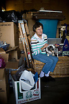 Carol Couts poses for a portrait in her Yuba City, California garage that she keeps packed with her belongings April 6, 2009. Couts is awaiting eviction from the home she has owned for over 30 years.