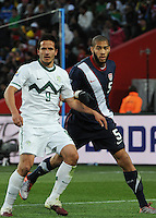 Defender Oguchi Onyewu carefully marks Slovenia's Zlatan Ljubijankic. The United States came from a 2-0 halftime deficit to Slovenia to earn a 2-2 draw their second match of play in Group C of the 2010 FIFA World Cup.