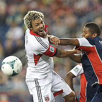 D.C. United midfielder Kyle Porter (19) and New England Revolution defender Andrew Farrell (2) on a corner kick. In a Major League Soccer (MLS) match, the New England Revolution (blue) tied D.C. United (white), 0-0, at Gillette Stadium on June 8, 2013.