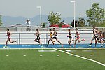 On the backstretch of the third lap of the 1600 meter run (L to R: Sam Levora, Ben Stout, Alberto De Los Reyes, Jeremy Stark, Daniel Perry, Harrison Hughes, Andrew Burgess, Dan Williams, Haydin Herndon) during the 4A Idaho Track and Field Championships on May 19, 2012 at Middleton High School, Middleton, Idaho.