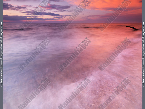 Lake Huron beautiful red sunset sky reflecting in water, Pinery Provincial Park, Grand Bend, Ontario, Canada.