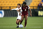 i02 December 2011: Florida State's Jamia Fields (4) is challenged by Stanford's Rachel Quon (11). The Stanford University Cardinal played the Florida State University Seminoles at KSU Soccer Stadium in Kennesaw, Georgia in an NCAA Division I Women's Soccer College Cup semifinal game.