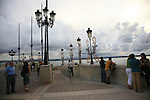 People enjoying and evening stroll along the walkway around La Foraleza in San Juan Puerto Rico