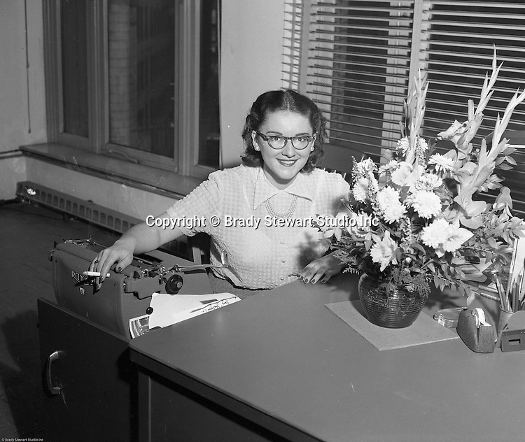 Pittsburgh PA:  Photo of Sally Stewart, office manager, for Brady Stewart Studio, Inc.  Sally was the daughter of Brady Stewart and sister of Brady Stewart Jr - 1953.