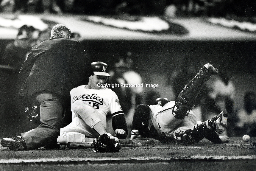 Oakland Athletics catcher Terry Steinbach slides safe at home. (1989 photo/Ron Riesterer/Photoshelter)