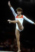 September 8, 1984; London, England, Great Britain; Artistic gymnast Sally Larner of Great Britain performs on balance beam at 1984 British National Championships at Wembley Arena. Copyright 1984 Tom Theobald