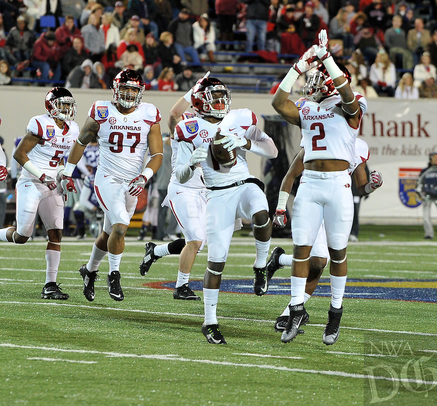 NWA Democrat-Gazette/MICHAEL WOODS &bull; @NWAMICHAELW<br /> University of Arkansas players Ryan Pulley (10_ and D.J.Dean (2) celebrate after a Kansas State turnover in the 4th quarter of the Razorbacks 45-23 win over Kansas State in the 57th annual AutoZone Liberty Bowl January 2, 2016.