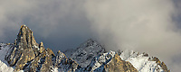 Clouds form over the spire shaped mount Snowden in the Brooks range mountains of Alaska's arctic.