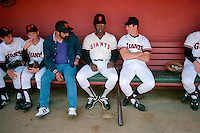 SAN FRANCISCO, CA - Bobby Bonds of the San Francisco Giants sits on the dugout bench and talks to Will Clark before a game at Candlestick Park in San Francisco, California in 1989. Photo by Brad Mangin