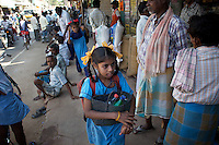 Vijyashree (foreground) and Vijita on their way to school after catching a shared rickshaw from their home village of Thazanguda into Cuddalore...Vijita (age 14) and Vijyashree (age 11) Viswanathan lost their mother and brother to the tsunami in 2004. They continue to live in the fishing village of Thazanguda with their father Viswanathan, his second wife Kayalvizhi and their two children Sanjay (age 3) and Monica (age 1). ..Until the beginning of the 2009 academic year in June, Vijita and Vijyashree attended the local Thazanguda school. This village school teaches pupils only until the 8th Standard and with Vijita now entering the 9th, it was decided that the two daughters remain together and both travel 3km to the local town school: the Government Girls High School, Venugopalapuram in Cuddalore. ..At the same time Viswanathan decided he would cease day-to-day care of his daughters and place them in the Government Home for Tsunami Children, also in Cuddalore. This was not a move welcomed by either Vijita or Vijyashree and one afternoon after just two weeks at the orphanage, the two girls ran away. At roll call in the orphanage that evening the alarm was sounded and the two sisters were eventually located in Thazanguda waiting for their father and Kayalvizhi who were both away at the time. Realising his daughters' unhappiness, Viswanathan then took them out of the Government home. ..According to her class teacher, Vijita often compares her step-mother to her mother and concludes that she wants her mother back. Vijita confides in her teachers that her stepmother is forever demanding that she and her sister Vijyashree undertake housework. This frustration at home is tempered by the genuine love both sisters have for their father and two younger siblings Sanjay and Monica. Vijita expresses a lonelyness without her mother. Pushpavalli concludes that &quot;Vijita wants something else beyond the love of her father and sister&quot;. ..Viswanathan appears genuinely to want the best f