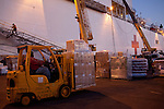 Relief supplies are loaded on board the USNS Comfort, a naval hospital ship, before its mission to help survivors of the earthquake in Haiti on Friday, January 15, 2010 in Baltimore, MD.