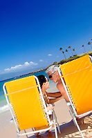 Romantic Couple On Beach With Yellow Beach Chairs