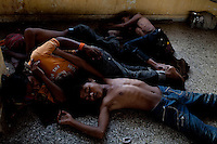 Youth sleep on the floor in the 3 storey abandoned building that has been made into the Motiakhan Shelter for homeless people, in Paharganj on 5th October 2010, in Old Delhi, India. Picture: Suzanne Lee for The Australian.