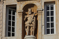Statue of King John III or Joao III, on the Porta Ferrea, designed 1634 by Antonio Tavares, on the library building at the University of Coimbra in the former Palace of the Alcazaba, Coimbra, Portugal. The Porta Ferrea is decorated with a statues by Manuel de Sousa of Wisdom, symbol of the University, and on either side, King John III or Joao III and King Denis I, founder of the University. The University of Coimbra was first founded in 1290 and moved to Coimbra in 1308 and to the royal palace in 1537. The buildings are listed as a historic monument and a UNESCO World Heritage Site. Picture by Manuel Cohen