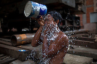 A man washes at a construction site in Yangon.