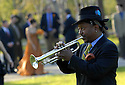 Trumpter Kermit Ruffins performs a dirge at the beginning of the Fertel wedding ceremony under the giant live oaks in Audubon Park, New Orleans, Saturday, March 10, 2007..(Cheryl Gerber for New York Times).. Weddings, New Orleans Photographer