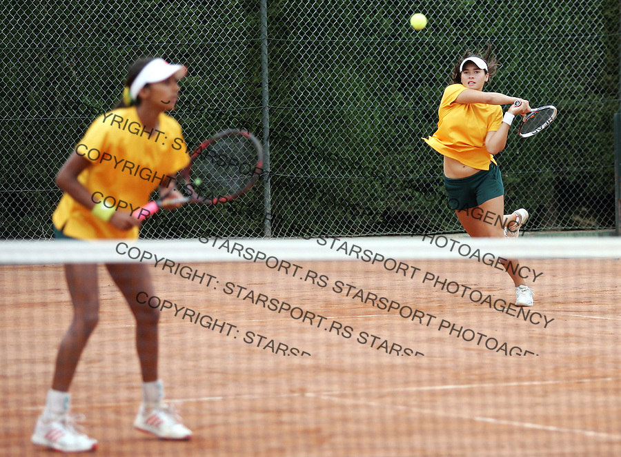 Junior Davis & Fed Cup Barcelona 2012.Latvia v Australia.Jelena Ostapenko and Darta Elizabeta Emulina (LAT)-Naiktha Bains and Isabelle Wallace (AUS).Barcelona, 27.09.2012..foto: Srdjan Stevanovic