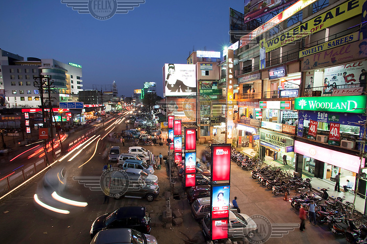 A street in Ranchi, the capital of Jharkhand, is lit up by illuminated advertising at night. As mining increases across the state and money flows into the capital, the formally sleepy town is rapidly expanding.  In the countryside however, where the mining actually takes place, most villages are still without electricity, running water or sanitation..
