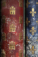 Detail of columns decorated with golden Castilian castles with red background and golden Fleur de lys with blue background, lower chapel of La Sainte-Chapelle (The Holy Chapel), 1248, Paris, France. The Fleur de lys and the Castilian castles symbolize Saint Louis and his mother, Blanche de Castille. La Sainte-Chapelle was commissioned to house Saint Louis' collection of Passion Relics, including the Crown of Thorns. The Sainte-Chapelle is considered among the highest achievements of the Rayonnant period of Gothic architecture. Picture by Manuel Cohen