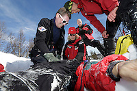 "Crew from Norwegian Air Ambulance practice rescue skills at Camp Torpomoen, a training facility..An avalanche viciitm, in the form of a dummy, is being ""resuscitated"" . by doctors and rescue paramedic. ..Bjarne Vikenes,  Ranveig Falkevik, Harald Bettum. Pilot Marius Malmo in background"