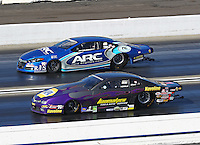 Feb 12, 2017; Pomona, CA, USA; NHRA pro stock driver Vincent Nobile (near) races alongside Alan Prusiensky during the Winternationals at Auto Club Raceway at Pomona. Mandatory Credit: Mark J. Rebilas-USA TODAY Sports