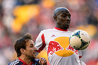 Ibrahim Sekagya (32) of the New York Red Bulls controls a ball in front of Mike Magee (9) of the Chicago Fire. The New York Red Bulls defeated the Chicago Fire 5-2 during a Major League Soccer (MLS) match at Red Bull Arena in Harrison, NJ, on October 27, 2013.