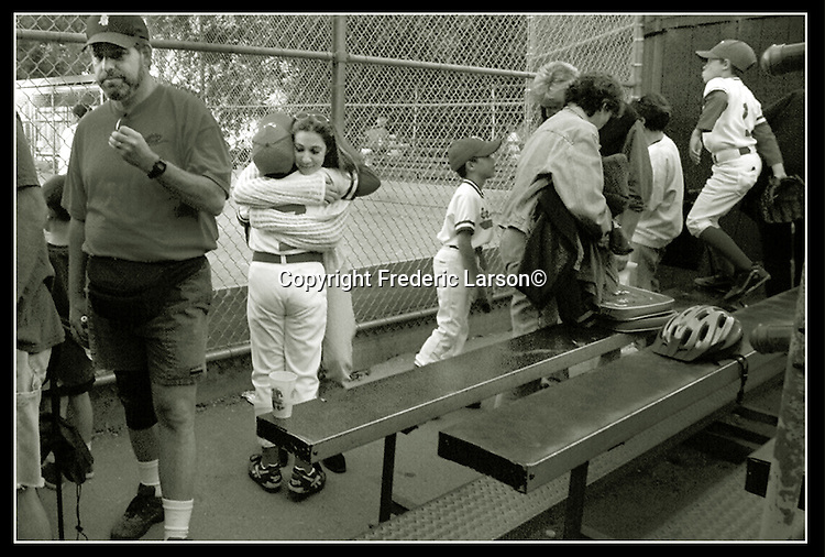 A Little Leaguer is consoled by his mother after the season ends.   San Francisco Chronicle/Frederic Larson.  7frl10aThe league baseball in Mill Valley California.