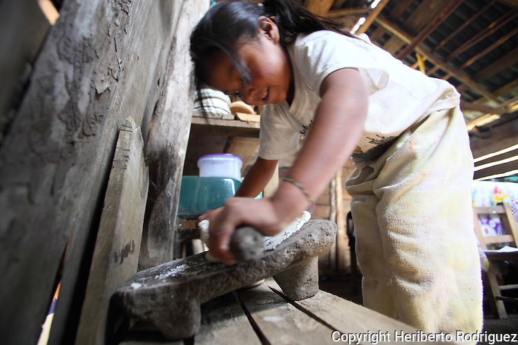 A Native nahuatl girl prepares tamales in her village of Acaxochitlan village, in northern state of Hidalgo, during the festivities of the Day of the Deads. Hundreds of Native villages pay homage to their deads on the eve of November 2 as a tradition since the preHispanic times. Photo by Heriberto Rodriguez