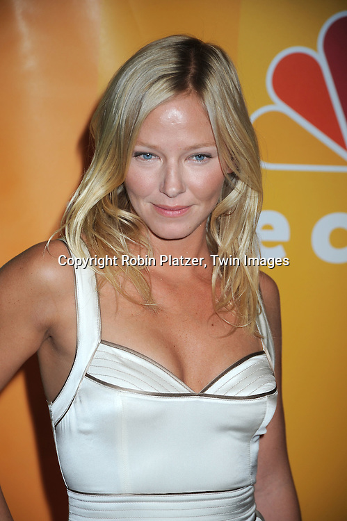 "Kelli Giddish of "" Chase""  posing for photographers at the NBC Universal's Upfront presentation of the 2010-2011 Season on May 17, 2010 at The New York Hilton Hotel in New York City."