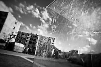 A plexiglass phone booth, covered by writings and scratches, is seen in front of the large apartment blocks in Alamar, a public housing periphery in the Eastern Havana, Cuba, 9 February 2009.