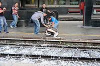 Roma 7 Luglio 2009.Manifestanti bloccano i binari della Stazione Termini per protestare contro il G8-.Manifestante fermato dalla polizia.Protesters blocking the tracks of the Termini Station to protest against G8.Demonstrator stopped by police.