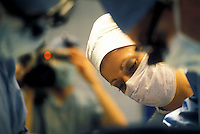 Stock photo of a surgical nurse observing a procedure.