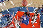 3 APRIL 2000: Udonis Haslem (#50) of the University of Florida splits two Michigan St. defenders on his way to the basket during the Division I Men's Basketball Tournament held in the RCA Dome in Indianapolis, IN. The Michigan St. Spartans went on to defeat the University of Florida Gators 89-76 for the championship title. Rich Clarkson/NCAA Photos