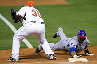 10 March 2009: #3 Willy Taveras of the Dominican Republic makes it back to first base safely to avoid a pick off play by #35 Randall Simon of the Netherlands during the 2009 World Baseball Classic Pool D game 5 at Hiram Bithorn Stadium in San Juan, Puerto Rico. The Netherlands pulled off second upset to advance to the secound round. The Netherlands come from behind in the bottom of the 11th inning and beat the Dominican Republic, 2-1.