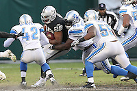 December 18, 2011 Oakland, CA: Oakland Raiders running back Michael Bush #29 and Detroit Lions defensive tackle Corey Williams #99during an NFL game played between the Oakland Raiders and the Detroit Lions at O.co Coliseum. The Lions defeated the Raiders 28-27.