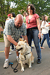 Garden City, New York, U.S. - June 6, 2014 - Husband CHRIS BUNGARZ, wife CHRIS BUNGARZ, and AMBER their Chow Chow Mix, of Garden City, are visiting the Garden City Belmont Stakes Festival, celebrating the 146th running of Belmont Stakes at nearby Elmont the next day. There was street festival family fun with live bands, food, pony rides and more, and a main sponsor of this Long Island night event was The New York Racing Association Inc.