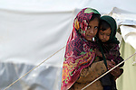 Following an October 8, 2005, earthquake, these siblings lived in a tent city outside Balakot sponsored by Church World Service/Action by Churches Together.