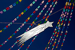 A hand-made star hangs with hand-cutted paper during festivities of the Huatlatlauca town in southern Puebla state, January 6, 2005.  © Photo by Heriberto Rodriguez