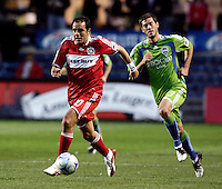 Chicago Fire midfielder Cuauhtemoc Blanco (10) dribbles away from Sounders FC midfielder Brad Evans (3).  The Chicago Fire tied the Seattle Sounders FC 1-1 at Toyota Park in Bridgeview, IL on May 2, 2009.