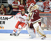 Matt Nieto (BU - 17), John Muse (BC - 1) - The visiting Boston College Eagles defeated the Boston University Terriers 3-2 to sweep their Hockey East series on Friday, January 21, 2011, at Agganis Arena in Boston, Massachusetts.