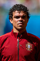 Pepe of Portugal who is later sent off for head butting Thomas Muller of Germany